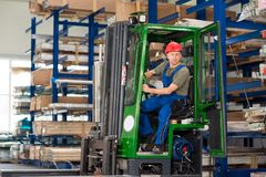 Worker in factory in lift truck Stock Photos