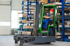 Worker in factory in lift truck with thumb up Stock Photography