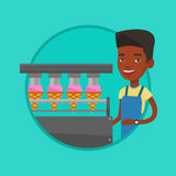 Worker of factory producing ice-cream. Stock Image