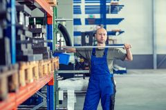 Worker in factory in stockroom. One worker in factory in stockroom stock photos