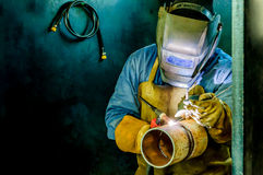 Worker factory welder Stock Images