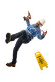 Worker Falling Down. Senior worker wearing hard hat falling down isolated over white background stock images