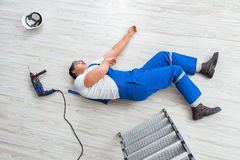 The worker after falling from height - unsafe behavior Royalty Free Stock Images