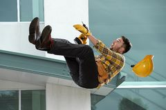 Worker Falling From Ledge. Outside building royalty free stock photos