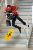 Worker Falling on Stairs. Hispanic worker carrying files falling on wet stairs stock photos