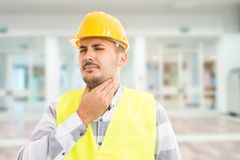 Worker feeling throat pain because of flu virus stock photo