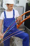 Worker with Fiber optic broadband cable. A Worker with Fiber optic broadband cable royalty free stock photography