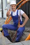 Worker at Fiber optic broadband construction site stock image