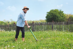 Worker in the field. Worker with a scythe in the field Stock Images