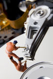 Worker figurine on hard drive Stock Photography