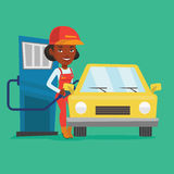 Worker filling up fuel into car. African-american gas station worker filling up fuel into the car. Female worker in workwear at the gas station. Young gas Royalty Free Stock Photos