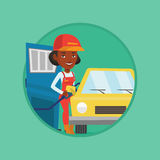 Worker filling up fuel into car. African-american gas station worker filling up fuel into the car. Gas station worker in workwear. Gas station worker refueling Royalty Free Stock Images