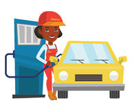 Worker filling up fuel into car. African-american gas station worker refueling a car. Gas station worker filling up fuel into car. Worker in workwear at the gas Stock Images