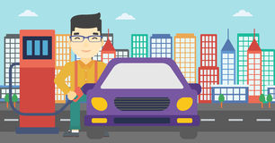 Worker filling up fuel into car. An asian man filling up fuel into the car. Man standing at the gas station and refueling a car. Vector flat design illustration Stock Images