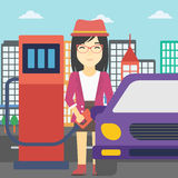 Worker filling up fuel into car. An asian woman filling up fuel into the car. Woman standing at the gas station and refueling a car. Vector flat design Royalty Free Stock Image