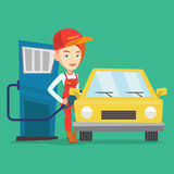 Worker filling up fuel into car. Caucasian friendly worker filling up fuel into the car. Smiling female worker in workwear at the gas station. Young gas station Royalty Free Stock Photos
