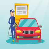 Worker filling up fuel into car. Caucasian friendly worker filling up fuel into the car. Smiling female worker in workwear at the gas station. Young gas station Royalty Free Stock Photography
