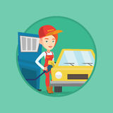 Worker filling up fuel into car. Caucasian gas station worker filling up fuel into the car. Gas station worker in workwear. Gas station worker refueling a car Stock Photography