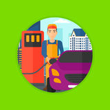 Worker filling up fuel into car. A worker filling up fuel into the car. Worker in workwear at the gas station. Gas station worker refueling a car. Vector flat Royalty Free Stock Image
