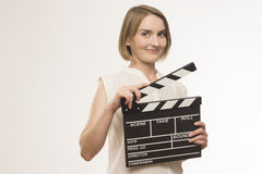 Worker film industry. Young girl with a clapperboard cinema Royalty Free Stock Photo