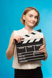 Worker film industry. Young girl with a clapperboard cinema Royalty Free Stock Photos