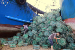 Worker finishing fishing cage Stock Images