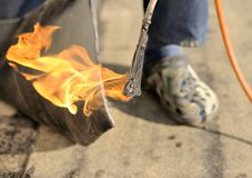 Worker with fire Stock Image