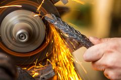 Worker and the fire in his hands. The man is making his living with pure fire coming out his hands stock image