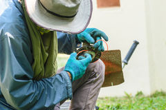 Worker fix the lawn mower. Royalty Free Stock Images