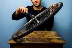 Worker fixing bicycle tyre Stock Image