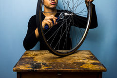 Worker fixing bicycle tyre Stock Photography