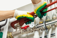 Worker fixing heating system Stock Images