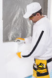 Worker fixing an insulation panel Stock Photography