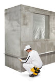 Worker fixing a lath on a corner Royalty Free Stock Photos