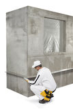 Worker fixing a lath on a corner Stock Image