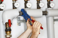 Worker is fixing a pipe Stock Photos