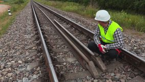 Worker fixing rails. In summer day stock footage