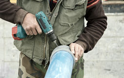 Worker fixing screws close up Royalty Free Stock Photo