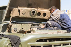 Worker Fixing Vehicle Engine Stock Images