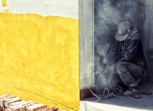 Worker fixing wall. A construction worker fixing the wall in a new building with an yellow outer wall royalty free stock photography
