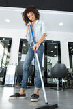 Worker floor cleaning at hairdressers Royalty Free Stock Images