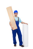 Worker with flooring materials. Worker with materials for installing laminate flooring Stock Photography