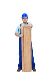 Worker with flooring planks Stock Image