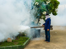 Worker fogging for dengue control Royalty Free Stock Image