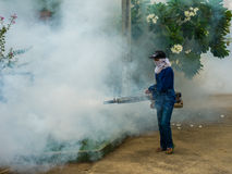 Worker fogging for dengue control Royalty Free Stock Images