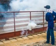 Worker fogging for dengue control Stock Photos