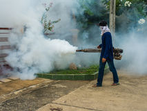 Worker fogging for dengue control Royalty Free Stock Photos
