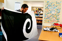 Worker fold the Koru flag Royalty Free Stock Photography