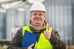 Worker with folder near the factory Stock Photography