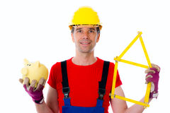 Worker with folding yardstick house and piggy bank Royalty Free Stock Images